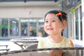 Little girl smiling outdoor closeup portrait of a Royalty Free Stock Photos