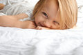 Little girl smiling after waking up Royalty Free Stock Photo
