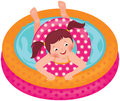 Little girl splashing in the summer inflatable pool Royalty Free Stock Photo