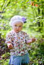 Little girl in spring forest portrait of Royalty Free Stock Photo