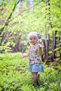Little girl in spring forest portrait of Royalty Free Stock Photos