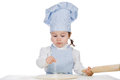 Little girl sprinkle flour on pizza dough beautiful cooking and with Stock Photo