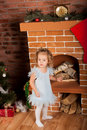 Little girl staing near fireplace Royalty Free Stock Photo