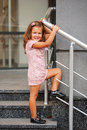 Little girl on the stairs posing Stock Images