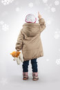 A little girl standing with his back pointing her finger. Royalty Free Stock Photo