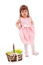 Little girl  standing near basket Stock Photo