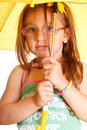 Little Girl standing with umbrella Stock Photography