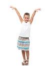 Little girl standing on white backdrop raised her hands up like she dansing Stock Photography