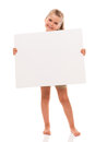 Little girl is standing on white background and holding white ca i can hold this piece of cardboard where could be your Stock Images