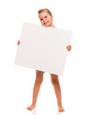 Little girl is standing on white background and holding white ca i can hold this piece of cardboard where could be your Royalty Free Stock Image
