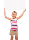 Little girl is standing on white background and holding white ca i can hold this piece of cardboard where could be your Stock Photo