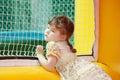 Girl jumping in bouncy castle