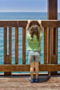 Little girl Staring at the sea Royalty Free Stock Photos