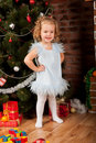 Little girl staying near Christmas tree Royalty Free Stock Photos