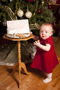 image photo : Little girl steals Santa cookie