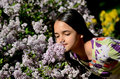 Little Girl Stops to Smell the Flowers Royalty Free Stock Photo