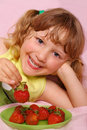 Little girl and strawberries Royalty Free Stock Image
