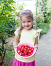 Little girl with strawberry Royalty Free Stock Photo
