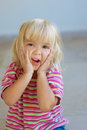 Little girl in striped dress poses Stock Photos