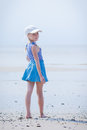 Little girl in a striped vest and hat Royalty Free Stock Photo
