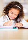 Little girl studying Royalty Free Stock Photography