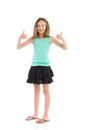 Little girl success young in teal shirt and black skirt showing thumbs up full length studio shot isolated on white Royalty Free Stock Photos