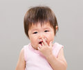 Little girl suck finger with gray background Royalty Free Stock Image