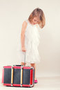 Little girl with a suitcase old isolated on white background Stock Photos