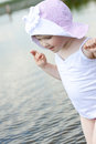 Little girl in summer lake Stock Photography