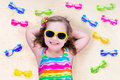 Little girl with sun glasses on a beach Royalty Free Stock Photo