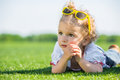 Little girl with sun glasses on a grass Stock Photo