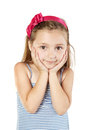 Little girl in sundress and band in hair stands Stock Photos