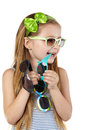 Little girl in sundress several sunglasses Stock Photo