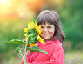 Little girl with sunflower Royalty Free Stock Photo
