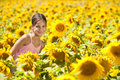 Little girl in a sunflowers happy field Royalty Free Stock Photography