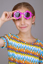 Little girl with sunglasses beautiful cheerful on gray background Royalty Free Stock Photos