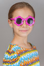 Little girl with sunglasses beautiful cheerful on gray background Royalty Free Stock Image