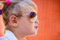 Little girl in sunglasses closeup profile of cool wearing Royalty Free Stock Photos