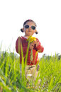 Little girl in sunglasses with dandelion flowers outdoors Stock Photos