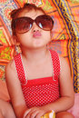 Little girl with sunglasses portrait of Royalty Free Stock Image