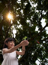 Little girl with sunlight in the forest Royalty Free Stock Photo