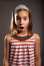 Little girl with surprise expression portrait of Stock Photo