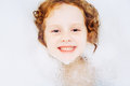 Little girl surrounded soap suds happy Royalty Free Stock Photography
