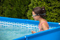 Little girl swimming in pool Stock Photos