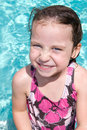 Little girl in swimming pool. Stock Photos