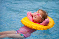 Little girl at swimming pool adorable with inflatable ring Royalty Free Stock Photography