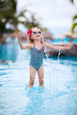 Little girl at swimming pool adorable playing a Stock Photography