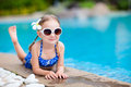 Little girl at swimming pool adorable relaxing by the Royalty Free Stock Photos