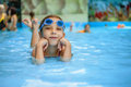 Little girl in swimming pool beautiful playing the at the resort Stock Photos
