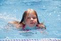 Little girl in swimming pool caucasian on blue water background Stock Photography